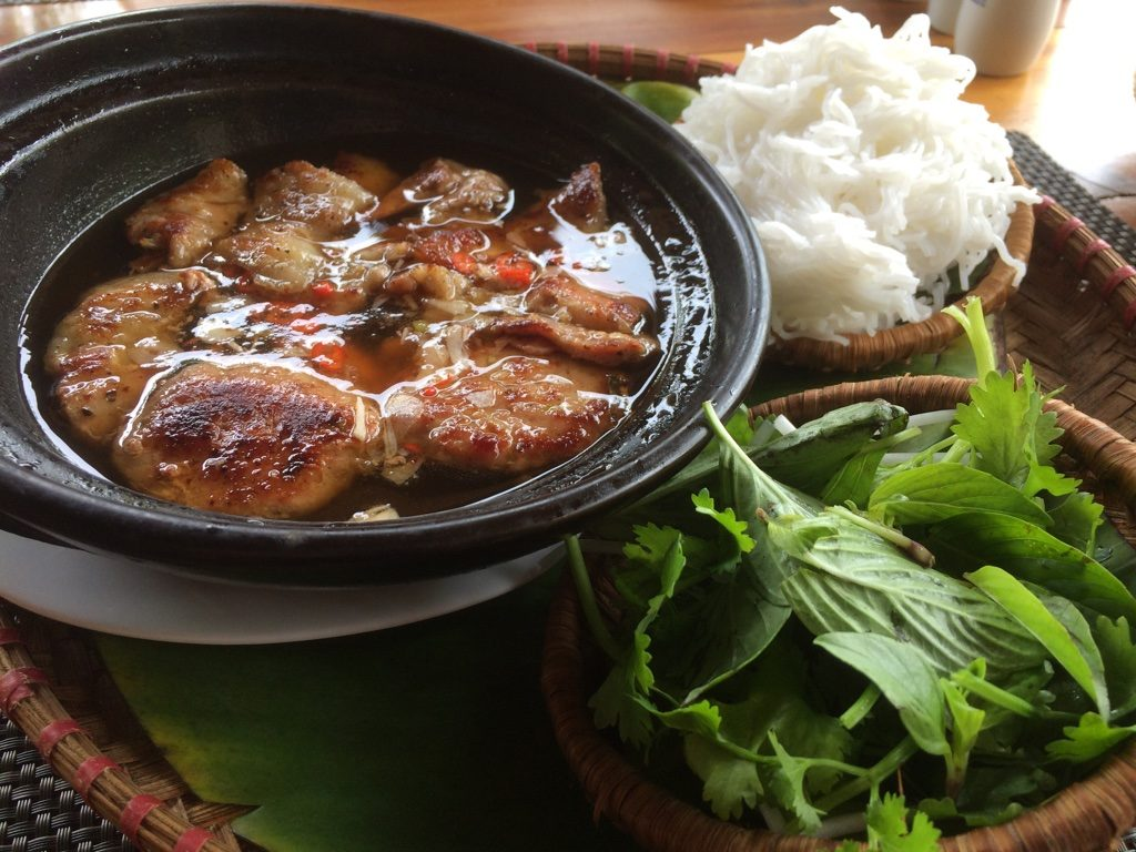 Bun cha (warm pork patties and pork belly in a fish sauce) : you dip the noodles in the sauce and eat it with fresh herbs - $9 CAD