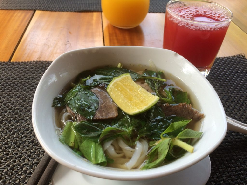 Fresh made pho bo (beef) for breakfast with freshly squeezed watermelon juice
